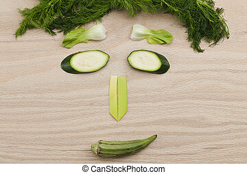 human face made up of vegetable pieces - Fresh green...