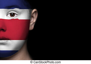 Human face painted with flag