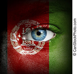 Human face painted with flag of Afghanistan