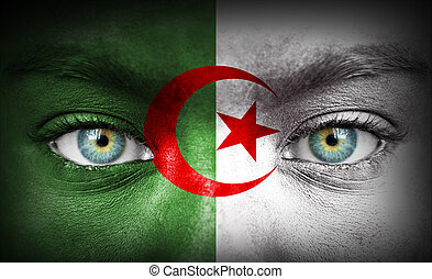 Human face painted with flag of Algeria