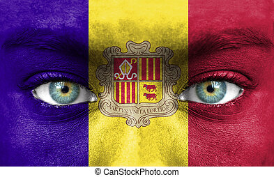 Human face painted with flag of Andorra
