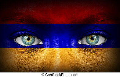 Human face painted with flag of Armenia