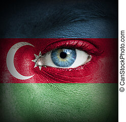 Human face painted with flag of Azerbaijan