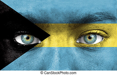 Human face painted with flag of Bahamas
