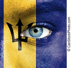 Human face painted with flag of Barbados