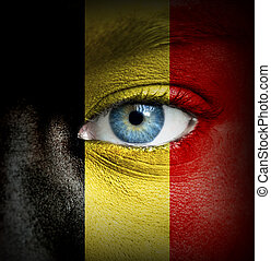 Human face painted with flag of Belgium