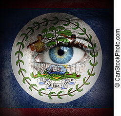 Human face painted with flag of Belize