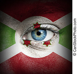 Human face painted with flag of Burundi