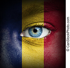 Human face painted with flag of Chad