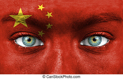 Human face painted with flag of China