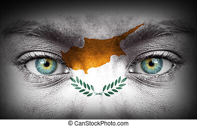 Human face painted with flag of Cyprus