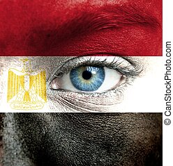 Human face painted with flag of Egypt