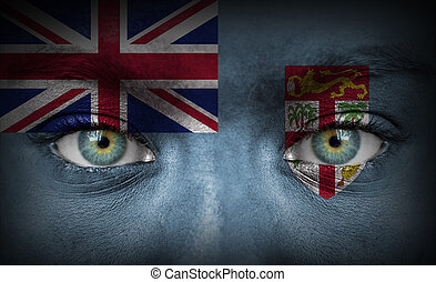 Human face painted with flag of Fiji