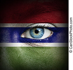 Human face painted with flag of Gambia