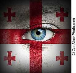 Human face painted with flag of Georgia