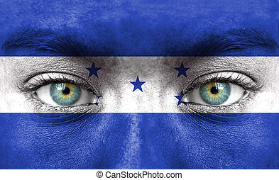 Human face painted with flag of Honduras
