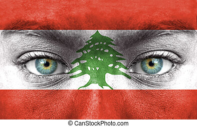 Human face painted with flag of Lebanon