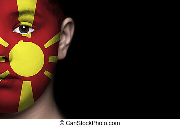 Human face painted with flag of Mac