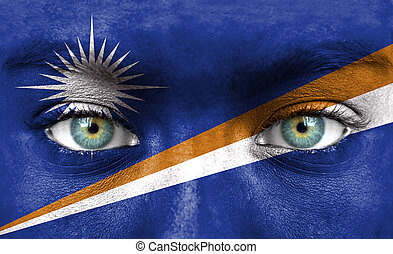 Human face painted with flag of Marshall Islands