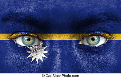 Human face painted with flag of Nauru