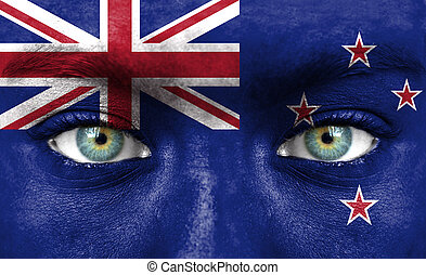 Human face painted with flag of New Zealand