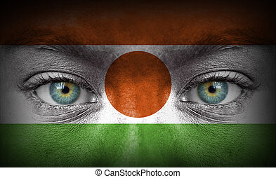 Human face painted with flag of Niger