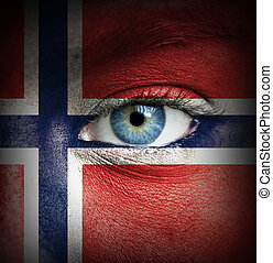 Human face painted with flag of Norway