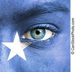 Human face painted with flag of Somalia