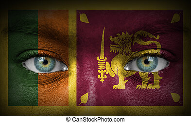 Human face painted with flag of Sri Lanka