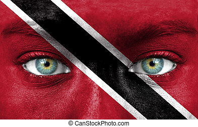 Human face painted with flag of Trinidad and Tobago