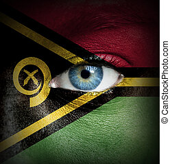 Human face painted with flag of Vanuatu
