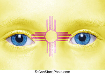 humans face with new mexico state flag