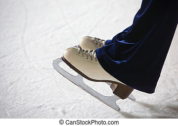 Human feet in fads standing on ice on the brink of an edge...