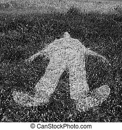 human figure outline imprinted on grass - Reclining human...