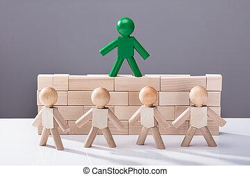 Human Figure Standing On Top Of Wooden Blocks