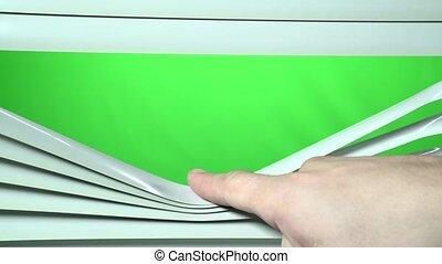 Human finger opens the white jalousie down. Green screen