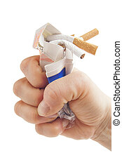 Human fist breaking pack of cigarettes on white background...