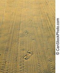 human footprints in the sand run