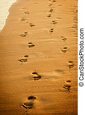 human footprints on the beach sand.