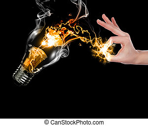 human hand and bulb - human hand, electric charge and light ...