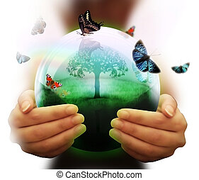 human hand and multicolored butterflies grass and a symbol of the environment collage