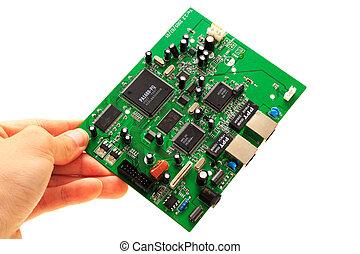 Human hand circuit board on white background - Human hand...