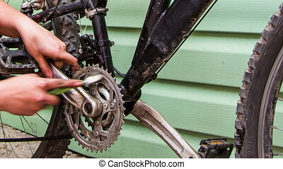 Human Hand Cleaning Bicycle Chainring With Brush - Closeup...