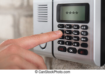 Human Hand Entering Security System Code