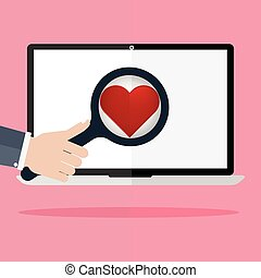 Human hand hold a magnifying for find love and heart icon on laptop monitor on pink rays in background. Concept for online internet dating.