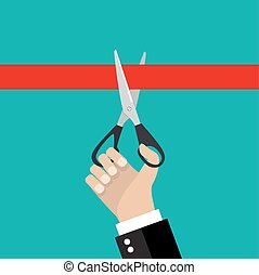 Human hand holding a pair of scissors