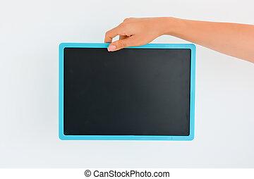 Human Hand holding an empty blackboard