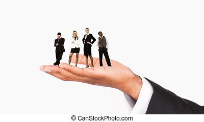 Human hand holding business people. Concept of giving work