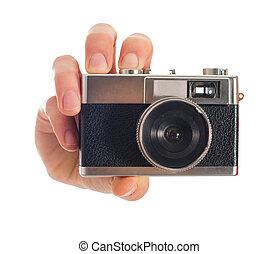 Human Hand Holding Camera On White Background