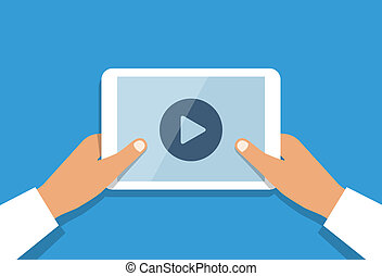 Human hand holds tablet pc with opened media player.